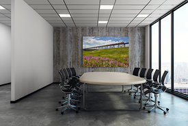 Modern meeting room with empty billboard