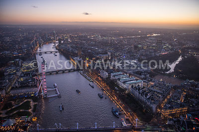 Dusk aerial view over River Thames and Westminster, Whitehall, Palace of Westminster, London Eye, London. Ministry of Defence...
