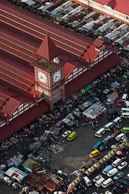 Aerial view of Stabroek market and clock tower with stalls and taxis on the road outside, Georgetown, Guyana, December 2009