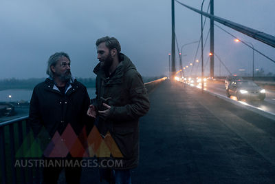 Father and son meeting on bridge, discussing business