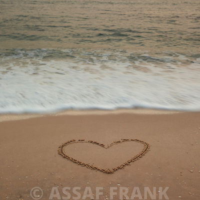 Sand writing - Heart shape drawn on beach