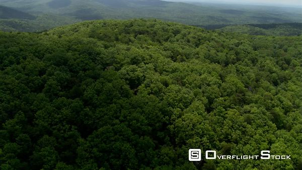 Low flight around a tree-covered hill in rural Georgia