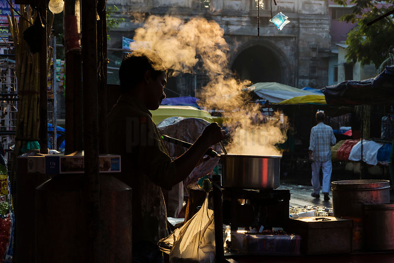 Chai Wallah Making Tea at the Lal Darwaja Old City Market at Sunrise
