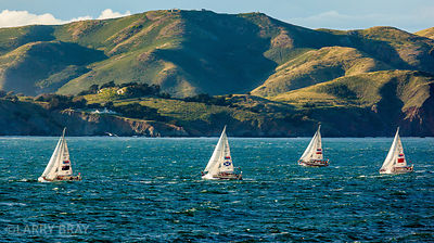 Sailing boats in San Francisco Bay with hills of Marin County in the background, California, USA
