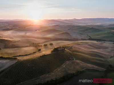 Aerial view of valley at sunrise, Tuscany, Italy