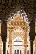 Ornate arches with arabesques in the Alhambra, Granada, Spain