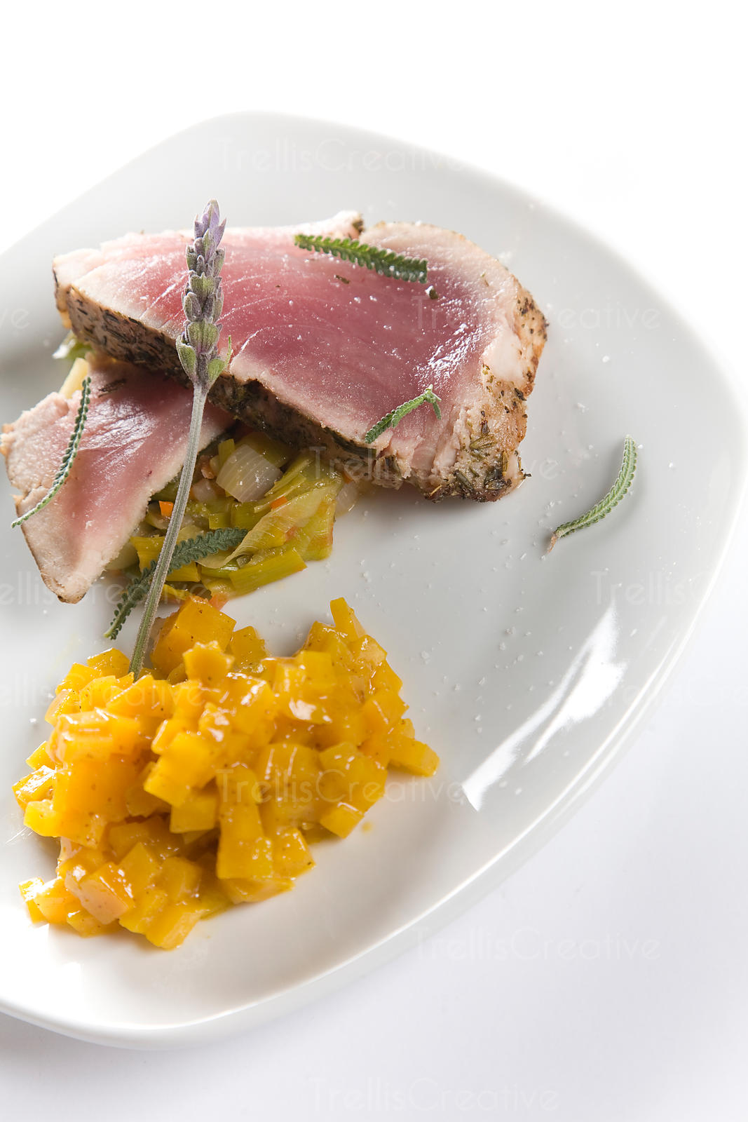 Rare tuna steak served with roasted golden yellow beets