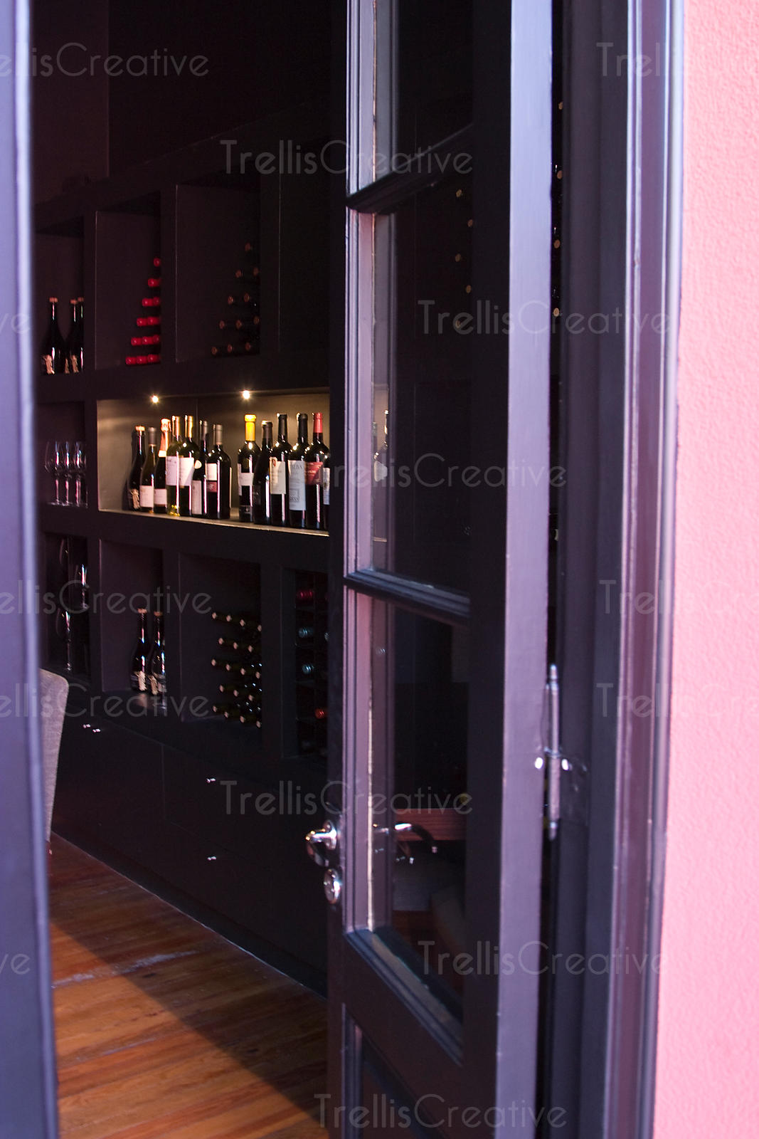 An open doorway into a wine cellar