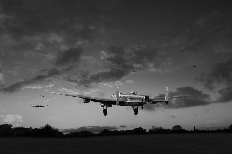 Lancasters taking off at sunset B&W version
