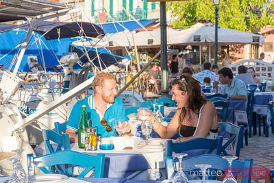 Couple eating out in a small greek village in summer. Kefalonia, Greek Islands, Greece