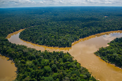 Aerial view of Mouth of the Yavari-Mirin River entering Yavari River and  Amazon Rainforest, Peru, July 2015.