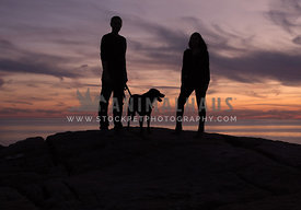 Dog and Couple in Silhouette
