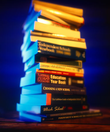 Pile of books stacked on table