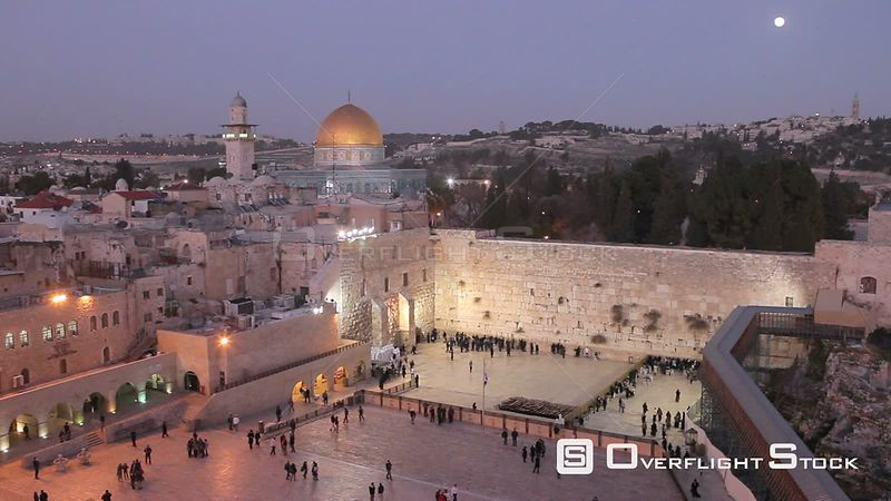 View overlooking people praying at the Wailing Wall, with the Dome of the Rock illuminated in the background, Temple Mount, J...