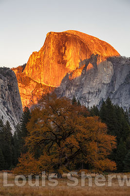 Half Dome turns orange in the setting sun