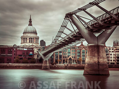View of St Paul's Cathedral and Millennium Bridge from river thames, London, UK