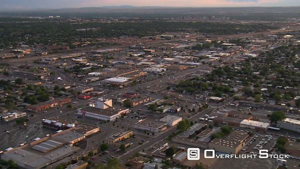 Flying over Albuquerque suburbs and outlying commercial areas.