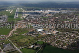 Manchester Airport showing Terminal buildings, runways and Ringway Trading Estate, Atlas Business Park and the old Ferrantic ...