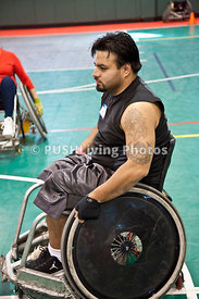 Man playing quad rugby