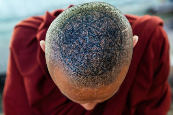 Tattoo on the top of a Monk's Head