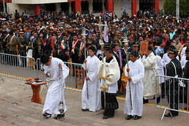 Assistants arriving with bible, lamps, crucifix and incense burner at start of central mass, Virgen de la Candelaria festival...