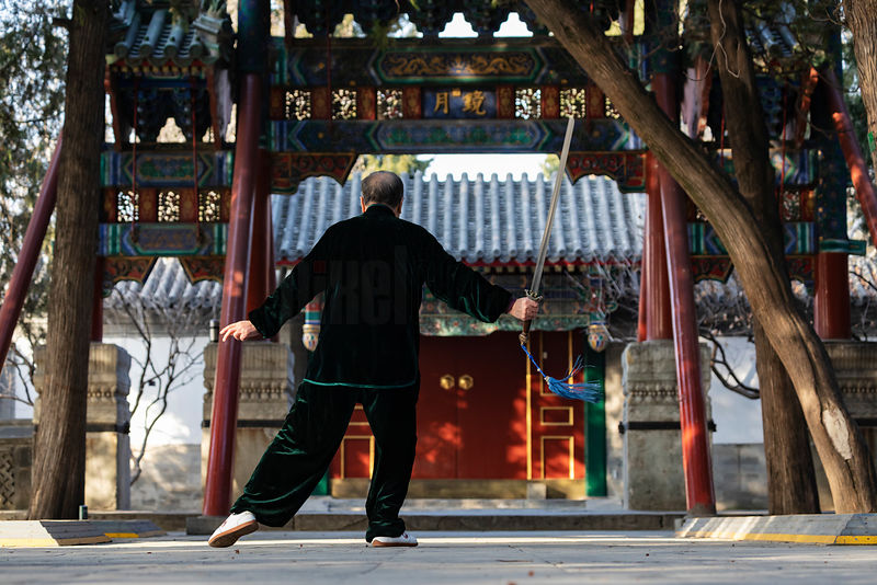 Man doing Tai Chi with a Sword