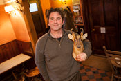UK - Berkshire - Mike Robinson, chef and restauranteur at his pub, the Potkiln with a stuffed Muntjac head that hangs over th...
