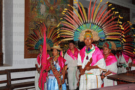 Machetero dancers parade inside Jesuit Mission church after mass, San Ignacio de Moxos, Bolivia