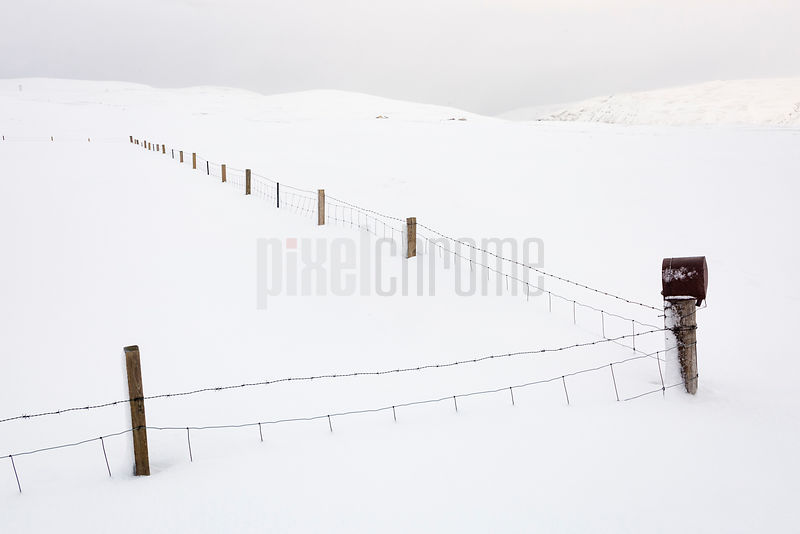 Fence Under Several Feet of Snow