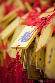 Yellow Buddhist prayer tablets in a temple in Pingyao, China
