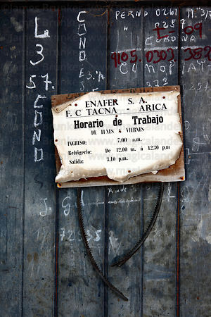 Old notice of working hours inside railway terminal of Tacna to Arica railway , Tacna , Per
