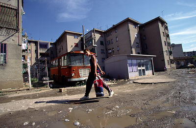 A child walks past the dilapidated former Socialist housing blocks in Tirana, Albania
