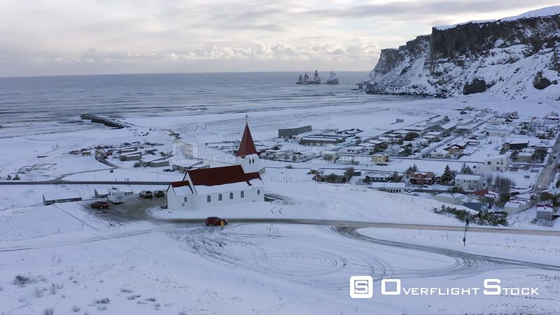Vik Town and Church in Iceland with Ocean Views Seen From the Air