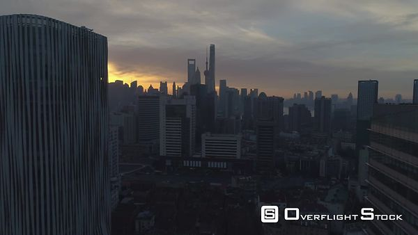 Shanghai Skyline at Sunny Sunrise. Aerial View. China. Drone is Flying Forward and Upward. Establishing Shot.