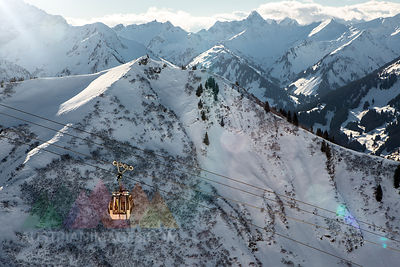 Austria, Vorarlberg, Riezlern, Mountainscape with cable car in winter