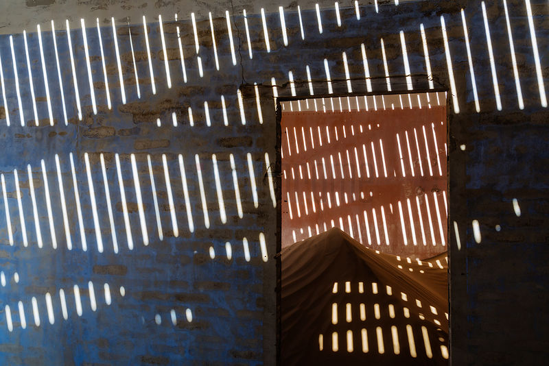 Light Patterns Through Roof Slats in Abandoned Building