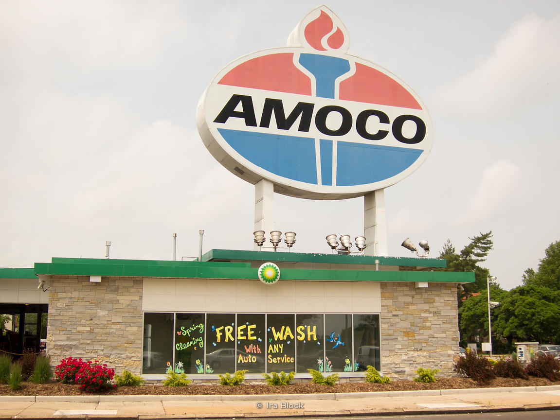 Ira Block Photography   An Amoco sign above a BP gas station on the