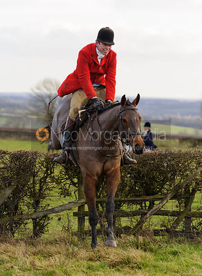 Jonty Evans jumping a hedge near Mr Wilson's covert.