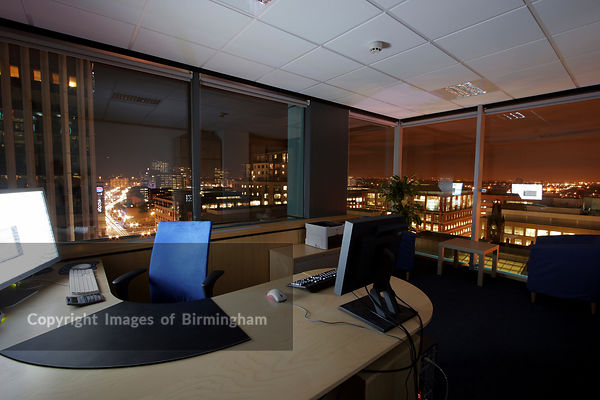 Quayside office building on Broad Street, Birmingham, UK. Interior of office space.
