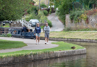 Walkers and boaters enjoying the canal