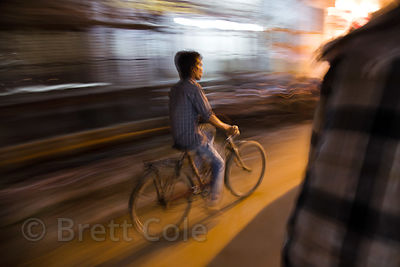 Nighttime bike traffic, Ramapura Luxa, Varanasi, India