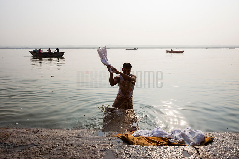 Dhobi Wallah Washing Hotel Linens in the River Ganges