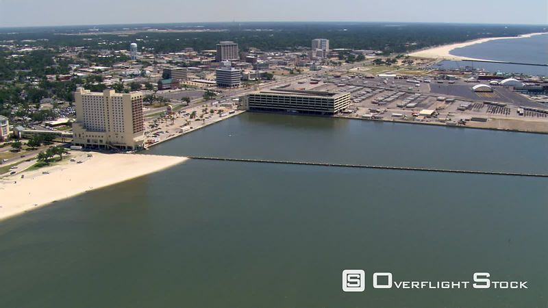 Flight along waterfront with wide view of Gulfport, Mississippi.