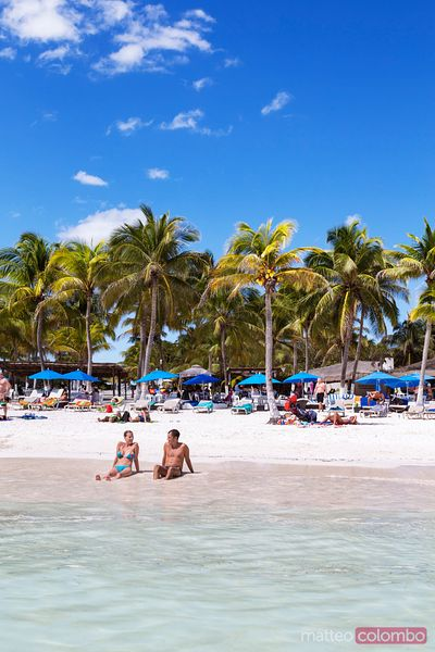 Tourist resort beach with palm trees, Riviera Maya, Mexico