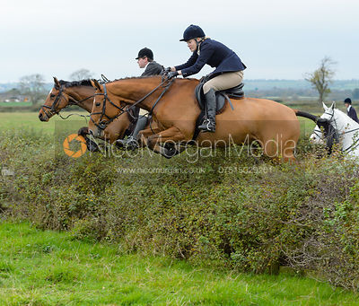Fiona Applewhite jumping a hedge at Sheepwash