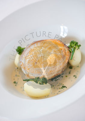 Wild Mushroom Pithivier with butttered spinach and tarragon cream sauce.