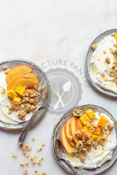 Gluten free breakfast to go - Greek yogurt, peach, mango and granola with honey and bee pollen.