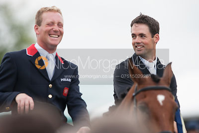 Jonathan Paget and Oliver Townend share a joke - prizegiving ceremony - Land Rover Burghley Horse Trials 2012.