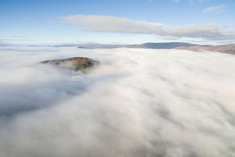 Ord Ban rising out above morning mist, temperature inversion, Cairngorms National Park, Scotland, UK, October 2016.