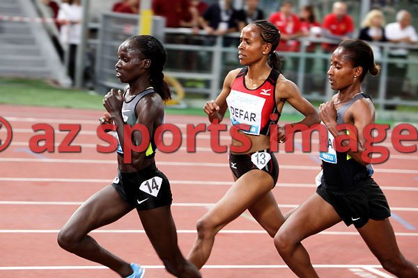 2012 Rome Golden Gala - Rome Diamond League,5000 Metres.Vivian Jepkemoi Cheruiyot from KEN wins the race 14:35.62..Meseret De...